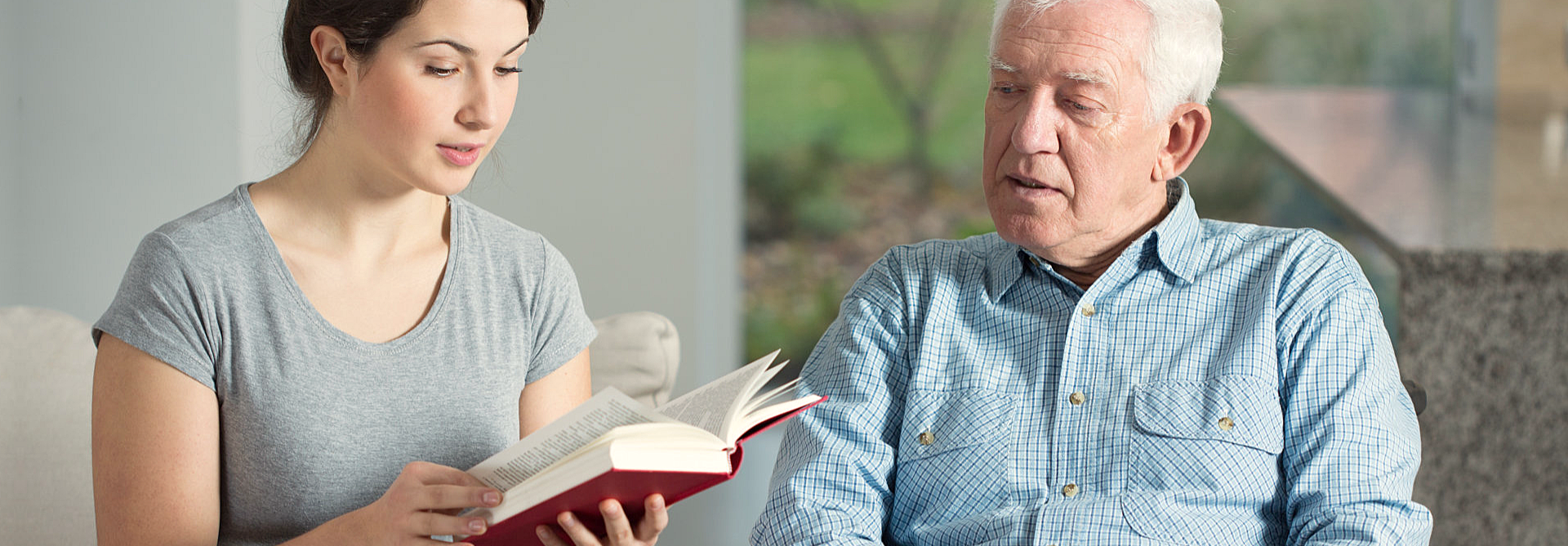 caregiver and elder reading bible