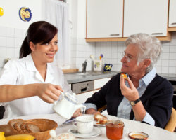 caregiver and patient having meal