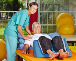 caregiver assisting patient in doing work-out